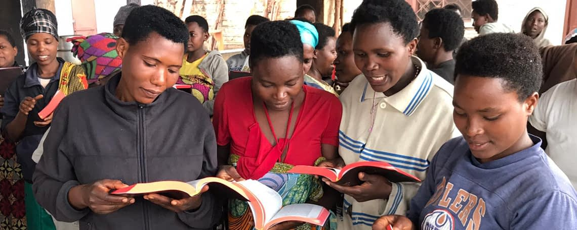 4 ladies eagerly read new bibles