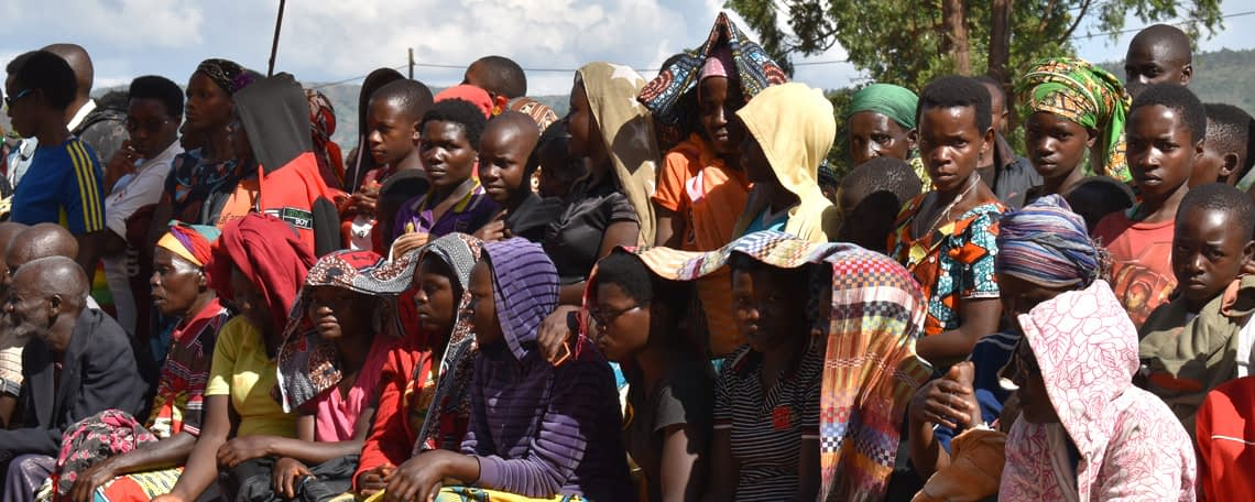 a group of Burundians listening to a talk