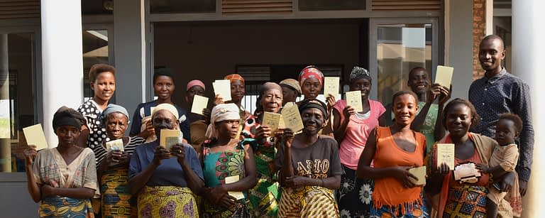 a group of ladies hold up their health cards happily