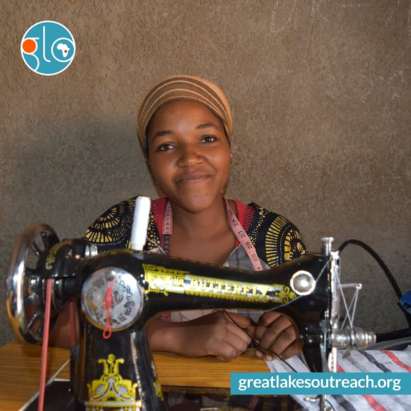 GLO sewing projects smiling woman sewing machine