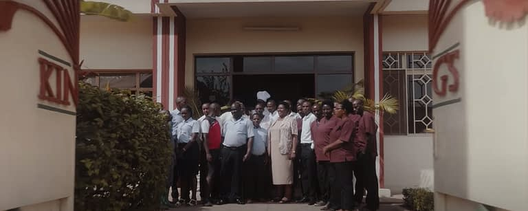 kcc staff stand at the front of the hotel smiling