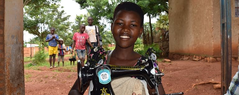 belise proudly holds her new sewing machine
