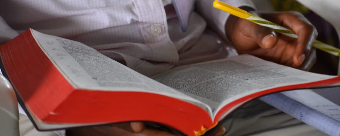 a student studies their bible